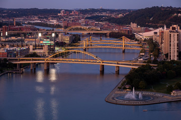 Cityscape of Pittsburgh and Evening Light.  Fort Duquesne Bridge in the Background.