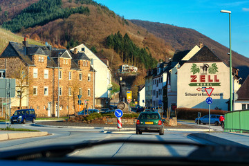 ZELL, GERMANY - MARCH 26, 2016: Entrance to Zell am Mosel with roundabout and view of the symbol and logo for the famous wine of Zell, Moselle, Rhineland-Palatinate, Germany, Europe.