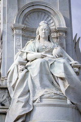 London, UK - September 24, 2006: Statue of an enthroned Queen Victoria, part of Victoria Memorial in front of Buckingham Palace in London city