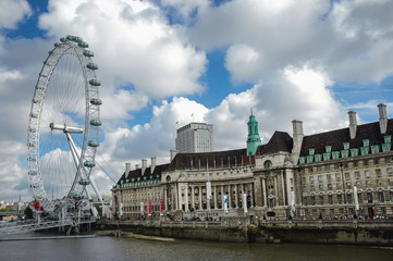 London, UK - September 24, 2006: London Eye observation wheel and County Hall building over Thames River in London city