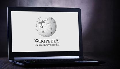 Laptop computer displaying logo of Wikipedia