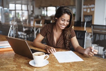 Business, gig economy concept, Charming young brazilian female entrepreneur sitting co-working...