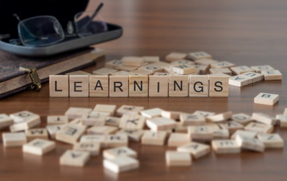learnings the word or concept represented by wooden letter tiles