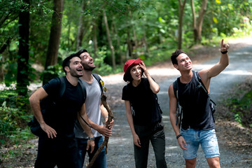 Group Of Friends Hiking Together Talk Happy while hiking up the Mountains