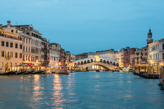 Grand Canal and Rialto Bridge at the dusk time. Venice, Italy.