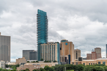 Fort Worth, USA - June 7, 2019: City in Texas with cityscape skyline and cloudy day and office buildings towers