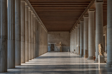 Foto auf Leinwand Altes Gebaude Passage with marble Ionic columns inside stoa of Attalos, ancient agora of Athens before sunset