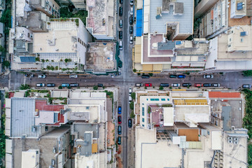 Overhead aerial drone shot of Athens street parked with cars near Lycabettus Hill in sunny summer Wall mural