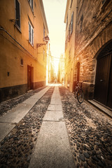 Narrow alley in old town Alghero