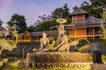 Mining statue in front of Rattanarangsan Palace or Throne Hall in Ranong, Thailand.
