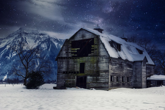 Magical Landscapes of the stars and the milky way with mountains and waterfalls with winter scenics for wallpaper backgrounds.