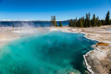 Papiers peints Bleu ciel Blue geyser basin with smoke boiling in West Thumb geyser basin.