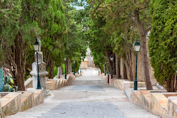 Staircase steps with trees alley to the calvary of pilgrimage church in Arta, Mallorca, Spain