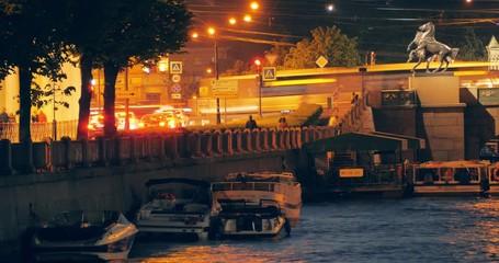 Fotobehang - Night traffic at Anichkov Bridge and Fontanka River in Saint Petersburg, Russia. Timelaps