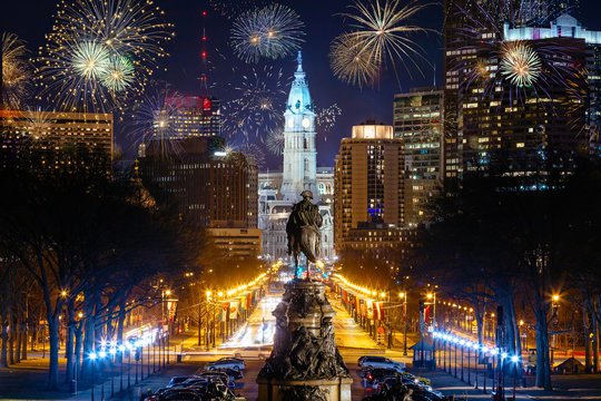 Colorful Fireworks  in Downtown Philadelphia, Pensilvania, USA. Cityscape celebrating New Years Eve with George Washington Statue in the Middle.