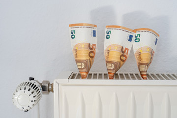 concept of energy saving - heating costs