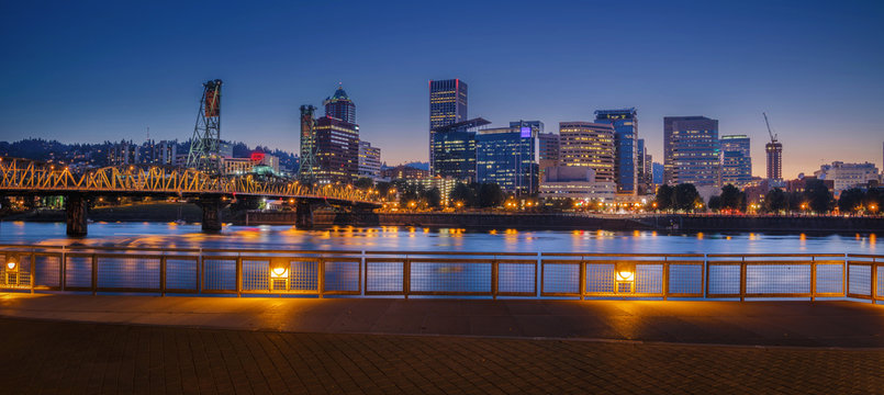 Portland early night with Willamette River and Hawthorne bridge, with wonderful yellow city lights, Oregon, USA