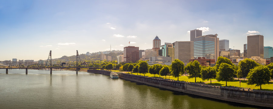 Beautiful Panorama of Downtown Portland  cityscape skyscrapers and Hawthorne Bridge during sunny day