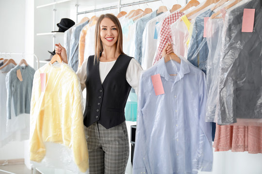 Young female worker in modern dry-cleaner's
