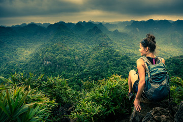 Cat Ba National Park Top of the Hill Young Woman enjoys beautiful view from the Ngu Lam peak in Kim Giao forest,