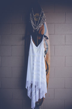 Wedding dress on surf board in Maui.