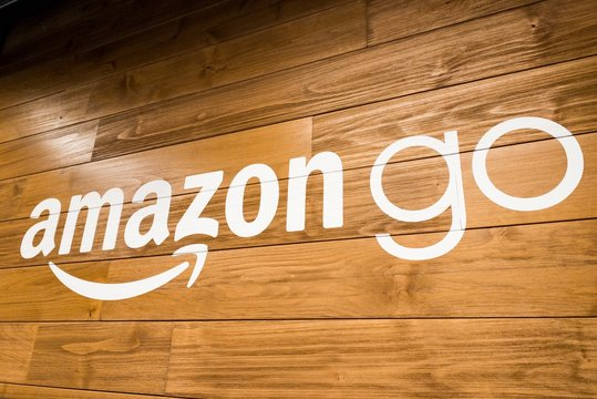 Amazon Go Brick and Mortar Store Logo Sign on Wood Background in San Francisco
