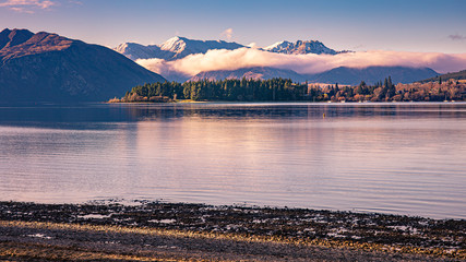 Eely Point and snow capped peaks of Mt Burke, Lake Wanaka, South Islands, New Zealand