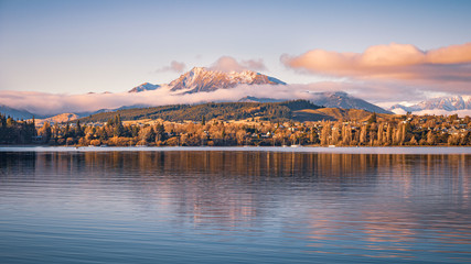 Snow capped Mt Maude reflecting on Lake Wanaka at sunset on a clear winter day, South Island, New Zealand