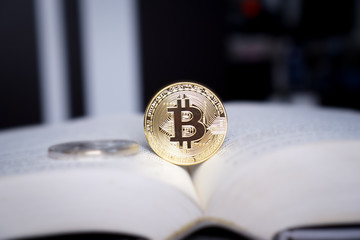 money concept with golden bitcoin coin on opening book