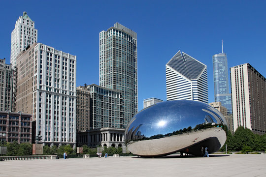 CHICAGO -  The Cloud Gate sculpture, popularly known as the bean, with Chicago's skyline