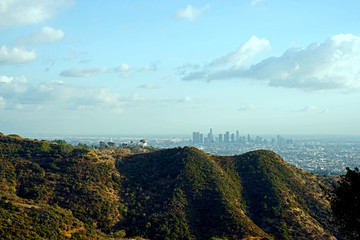 Griffith Observatory perched high in the Santamonica Mounains overlooking a smoggy Los Angeles City Wall mural