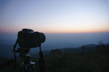 A camera capturing sunrise at mountain view