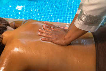 Professional masseuse working with her client recreation rejuvenation pampering therapy relaxing .