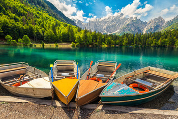 Wall Mural - Admirable alpine landscape with colorful boats, Lake Fusine, Italy, Europe