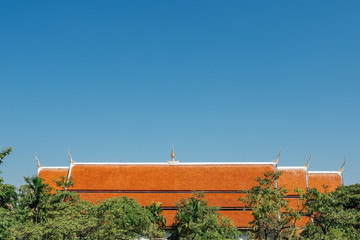 Roof of the buddhist thai temple with a blue sky