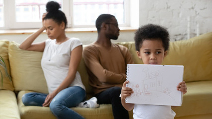Upset little boy suffer from parents fight or divorce