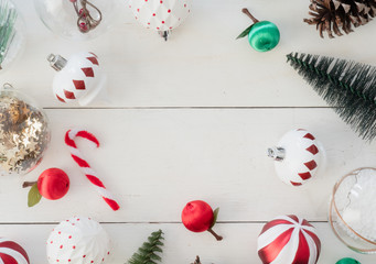 top view of Christmas and new year holidays concept with Pine cones, gift box, Christmas ball and Christmas decorations on white wooden background.