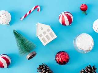 top view of Christmas and new year holidays concept with Pine cones, gift box, Christmas ball and Christmas decorations on blue table background.