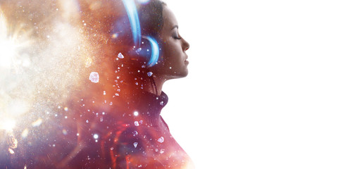 Portrait of woman in headphones listening music with closed eyes. Double exposure of female face...