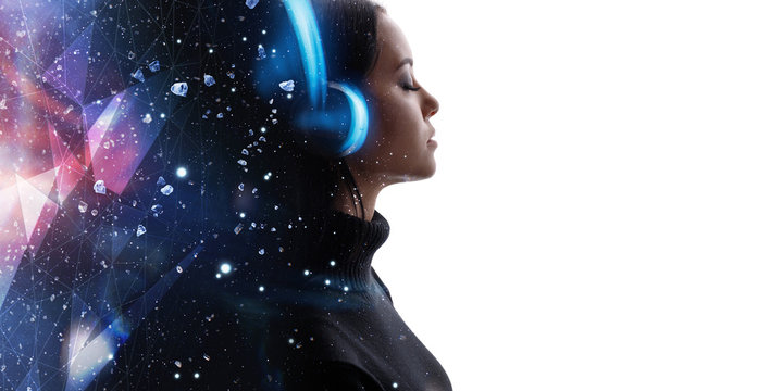 Portrait of woman in headphones listening music with closed eyes. Double exposure of female face and galaxy isolated on white background. Digital art. Blue neon light. Free space for text.