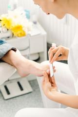 Podiatrist working on men's feet