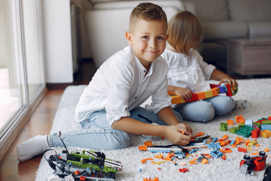 Brother and sister in a playing room. Children playing with a lego