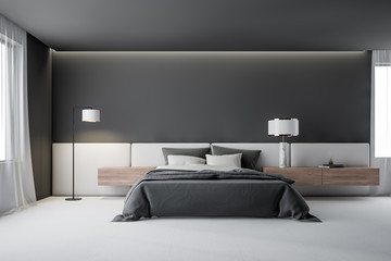 Gray master bedroom interior with lamp