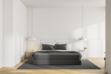 White master bedroom interior, wood floor