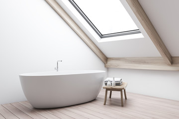 Attic white bathroom interior with tub and bench