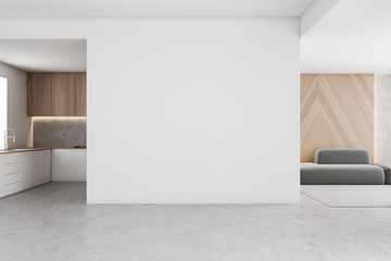 White kitchen and living room with mock up wall