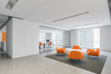Orange armchairs waiting room in office
