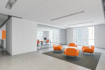Orange armchairs waiting room in office