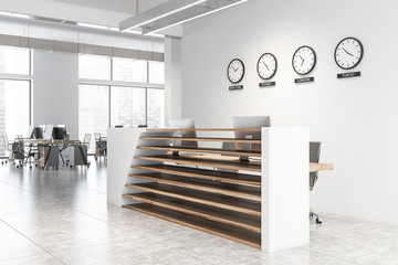 Reception hall with clocks in white office