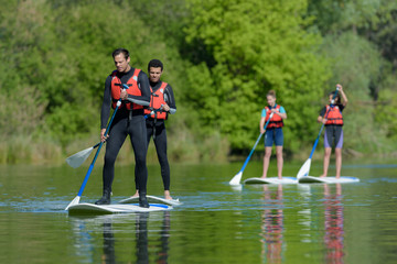 stand up paddle group on the lake